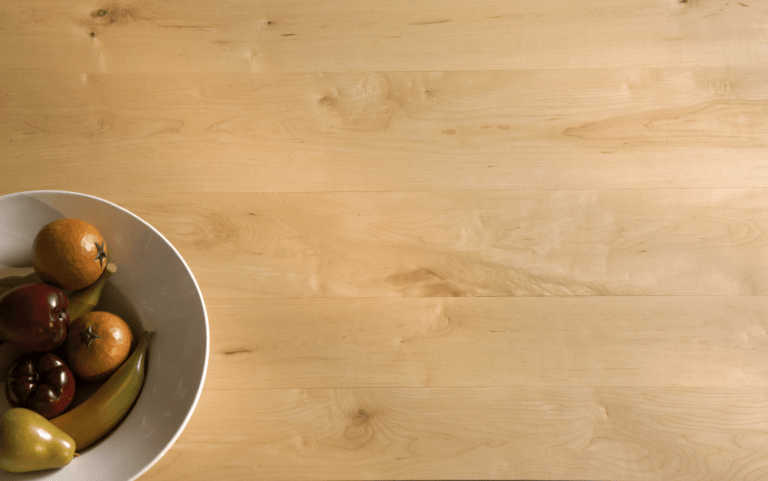 maple wide plank floor with fruit bowl