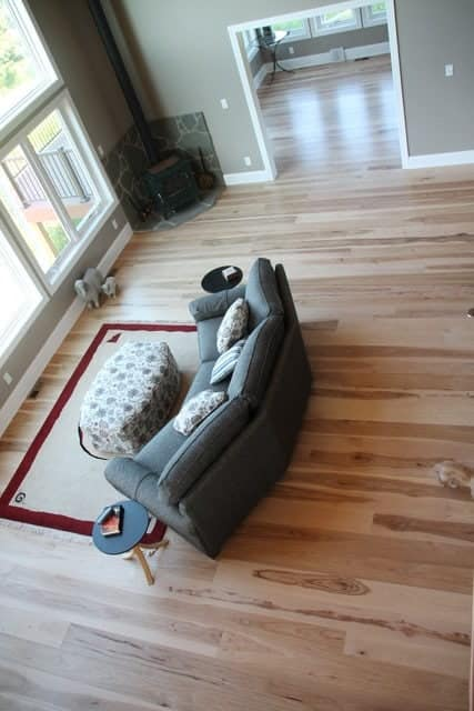 living room with wide plank flooring