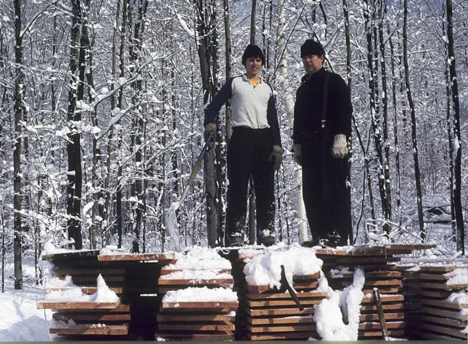 Don and Dale standing on woodpile 1984