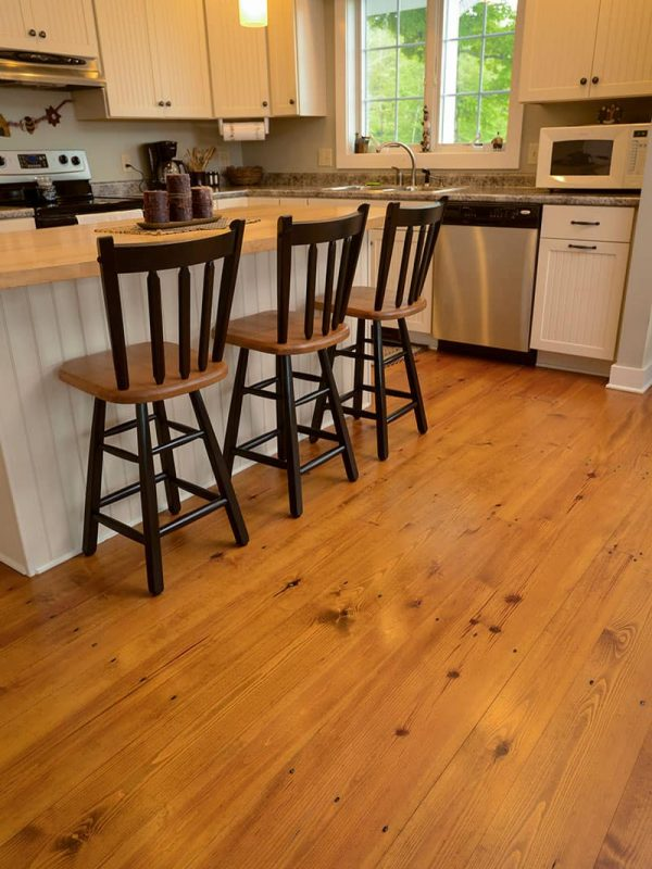 heart pine wide plank flooring used in kitchen