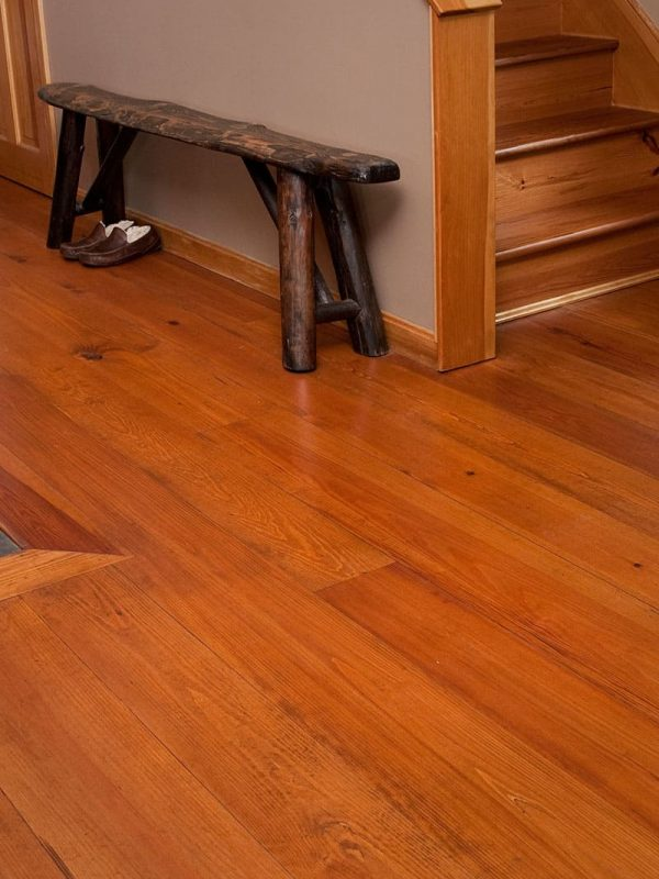 heart pine flooring with bench and staircase