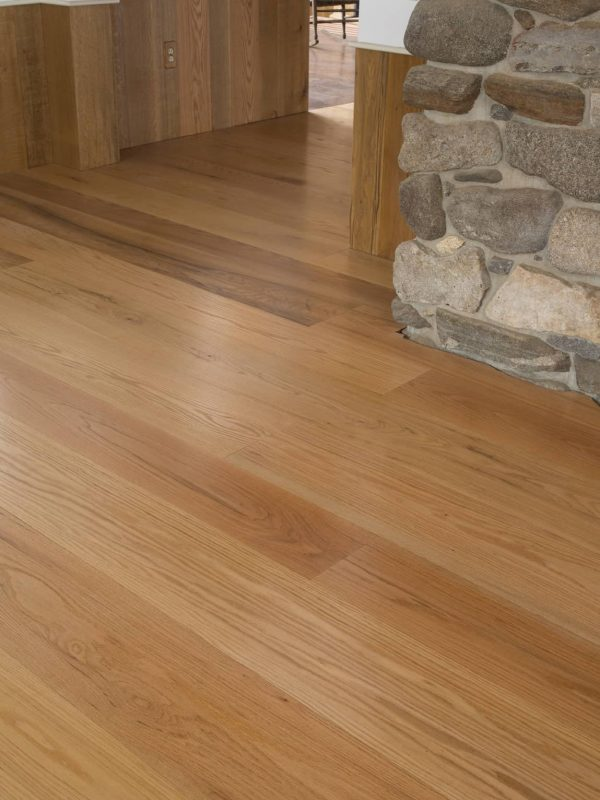 wide palnk flooring around stone