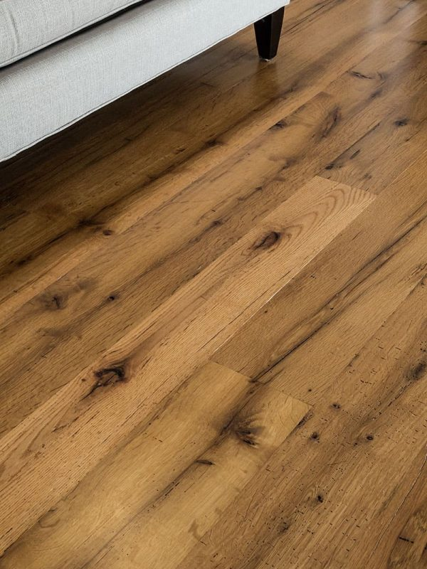 Reclaimed oak wide plank floor with couch