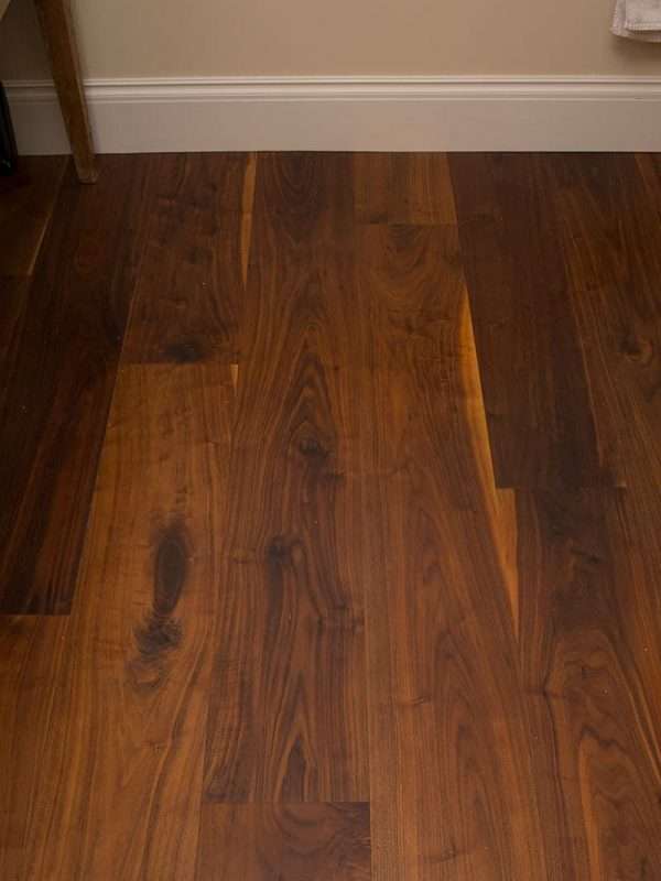 walnut wide plank flooring close up
