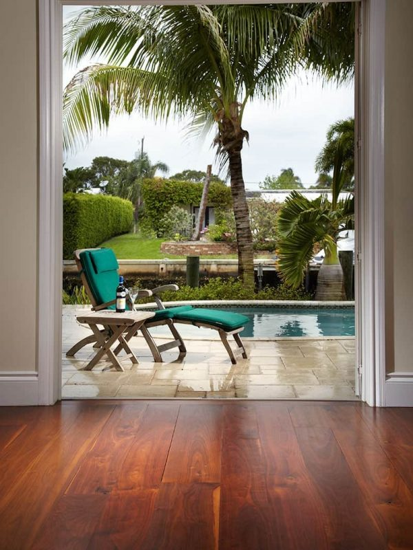 walnut wide plank flooring view outside to pool