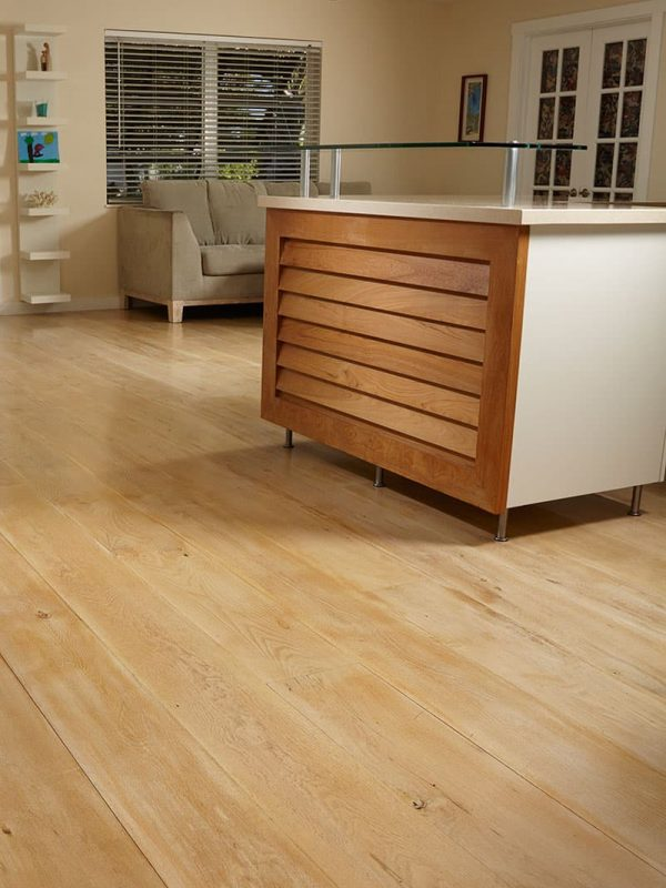 White oak wide plank flooring in kitchen at a different angle