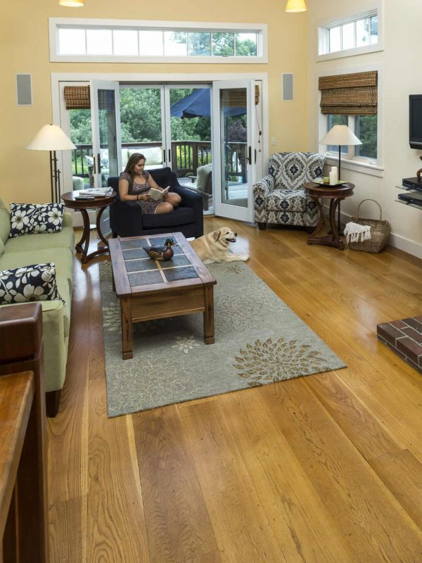White oak wide plank flooring with girl reading